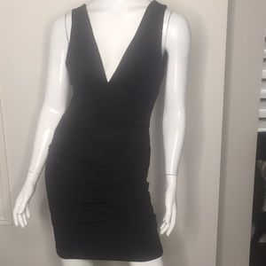Body Con fitted Black dr as with Ruching. NWT